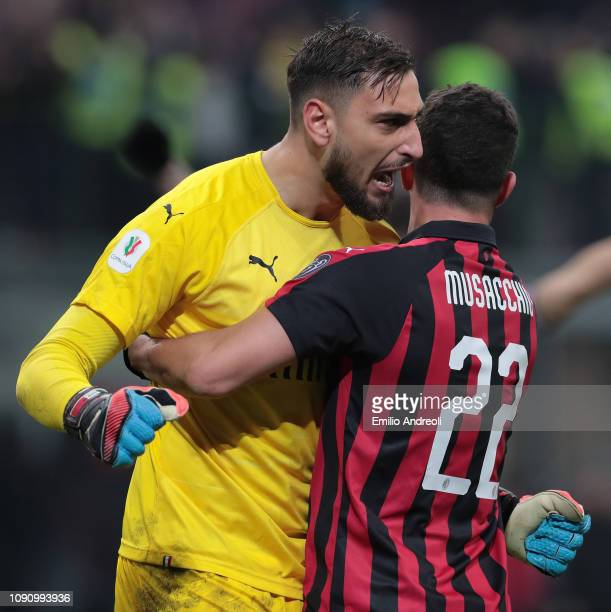 Gianluigi Donnarumma of AC Milan celebrates the victory with his teammate Mateo Musacchio at the end of the Coppa Italia match between AC Milan and...