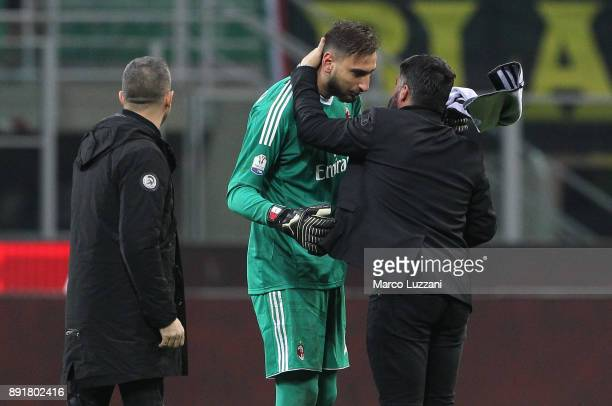 Gianluigi Donnarumma of AC Milan embraces AC Milan coach Gennaro Gattuso salute the crowd at the end of the Tim Cup match between AC Milan and Hellas...