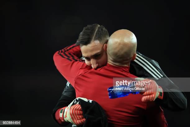 Gianluigi Donnarumma of AC Milan embraces goalkeeping coach Alfredo Magni during the UEFA Europa League Round of 16 2nd leg match between Arsenal and...