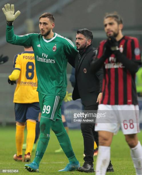 Gianluigi Donnarumma of AC Milan embraces his coach Ivan Gennaro Gattuso and greets the fans at the end of the Tim Cup match between AC Milan and...