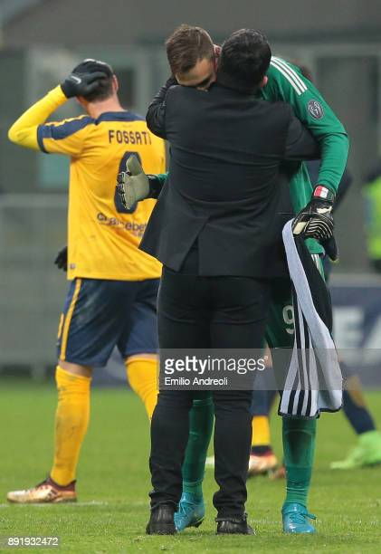 Gianluigi Donnarumma of AC Milan embraces his coach Ivan Gennaro Gattuso at the end of the Tim Cup match between AC Milan and Hellas Verona FC at...