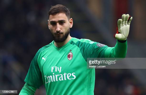 Gianluigi Donnarumma of AC Milan gestures during the Coppa Italia Semi Final match between AC Milan and Juventus at Stadio Giuseppe Meazza on...