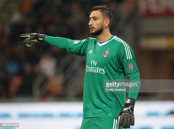 Gianluigi Donnarumma of AC Milan gestures during the Tim Cup match between AC Milan and Hellas Verona FC at Stadio Giuseppe Meazza on December 13...