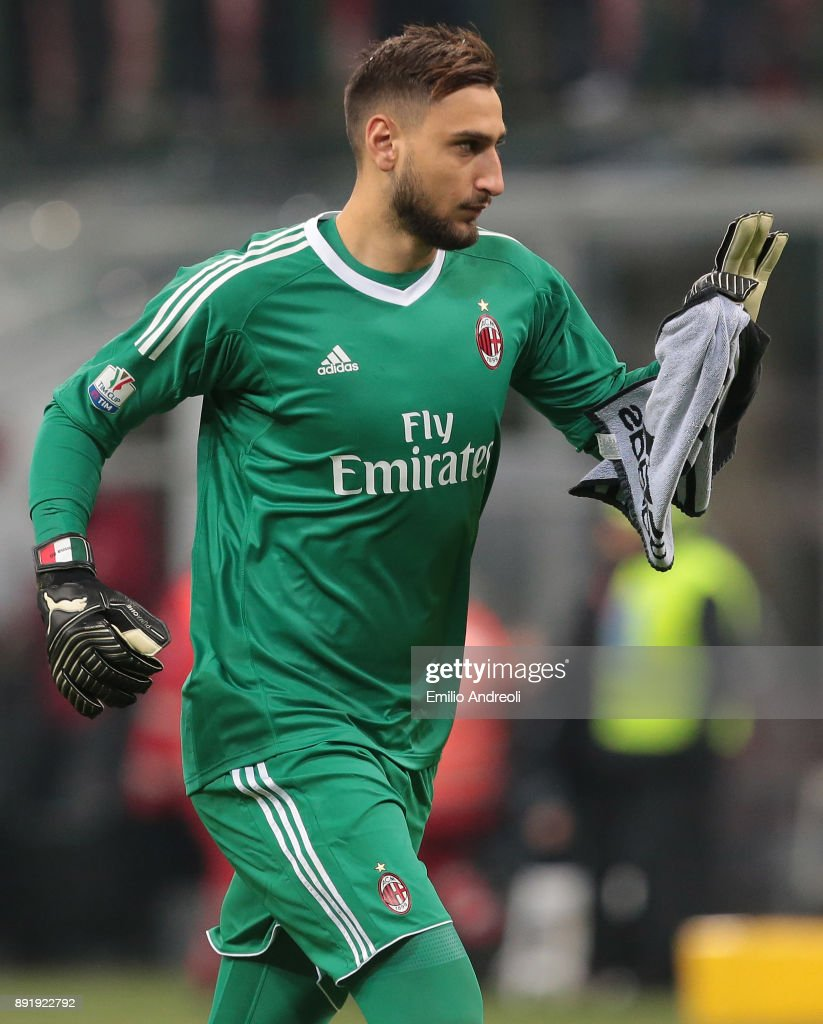 Gianluigi Donnarumma of AC Milan gestures during the Tim Cup match between AC Milan and Hellas Verona FC at Stadio Giuseppe Meazza on December 13, 2017 in Milan, Italy.
