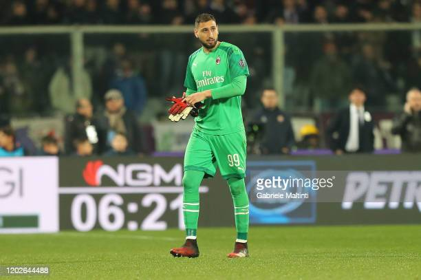 Gianluigi Donnarumma of AC Milan leaves the field injured during the Serie A match between ACF Fiorentina and AC Milan at Stadio Artemio Franchi on...