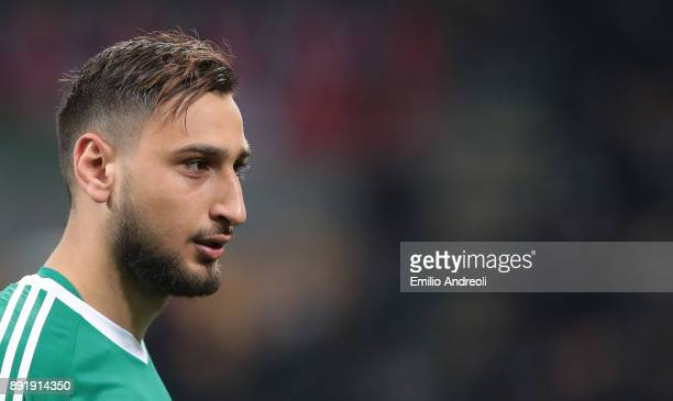 Gianluigi Donnarumma of AC Milan looks on during the Tim Cup match between AC Milan and Hellas Verona FC at Stadio Giuseppe Meazza on December 13...