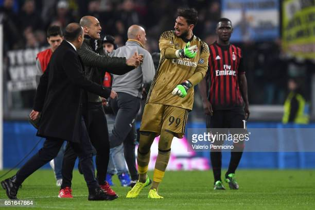 Gianluigi Donnarumma of AC Milan reacts against assistant referee at the end of the Serie A match between Juventus FC and AC Milan at Juventus...