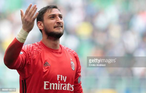 Gianluigi Donnarumma of AC Milan salutes the fans at the end of the Serie A match between FC Internazionale and AC Milan at Stadio Giuseppe Meazza on...