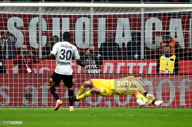 Gianluigi Donnarumma of AC Milan saves a penalty kick from Khouma Babacar of US Lecce during the Serie A football match between AC Milan and US...