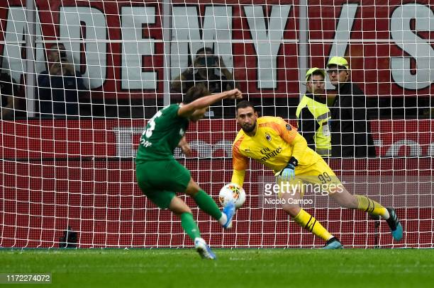 Gianluigi Donnarumma of AC Milan saves a penalty of Federico Chiesa of ACF Fiorentina during the Serie A football match between AC Milan and ACF...