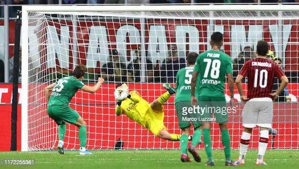 Gianluigi Donnarumma of AC Milan saves a penalty-kick of Federico Chiesa of ACF Fiorentina during the Serie A match between AC Milan and ACF...