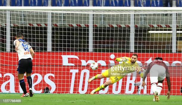 Gianluigi Donnarumma of AC Milan saves a penaltykick of Ruslan Malinovskyi of Atalanta BC during the Serie A match between AC Milan and Atalanta BC...