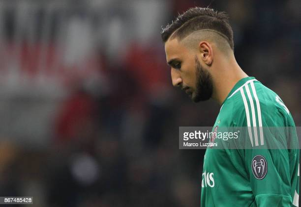 Gianluigi Donnarumma of AC Milan shows his dejection during the Serie A match between AC Milan and Juventus at Stadio Giuseppe Meazza on October 28...