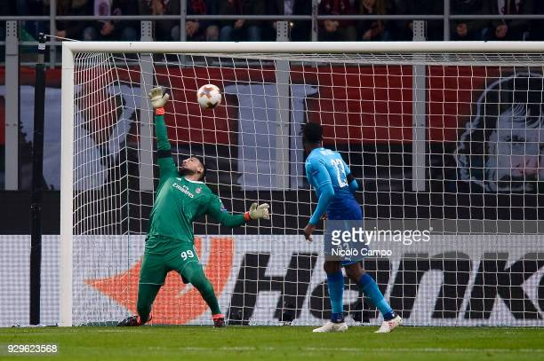 Gianluigi Donnarumma of AC Milan suffers a goal from Henrikh Mkhitaryan of Arsenal FC during the UEFA Europa League Round of 16 match between AC...