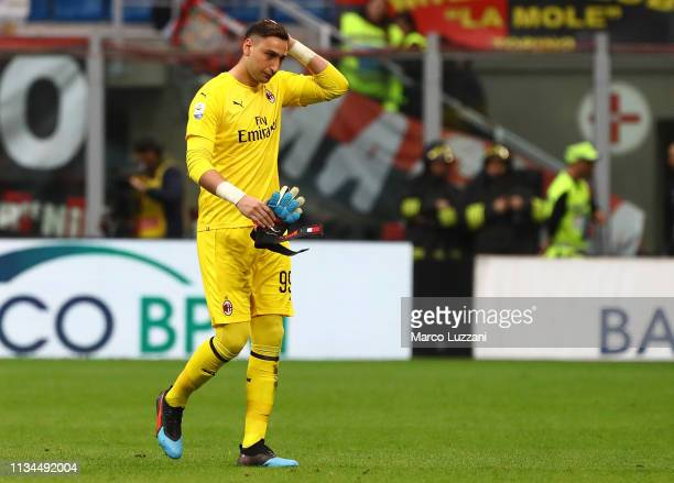 Gianluigi Donnarumma of AC Milan walks off with an injury during the Serie A match between AC Milan and Udinese at Stadio Giuseppe Meazza on April 2...