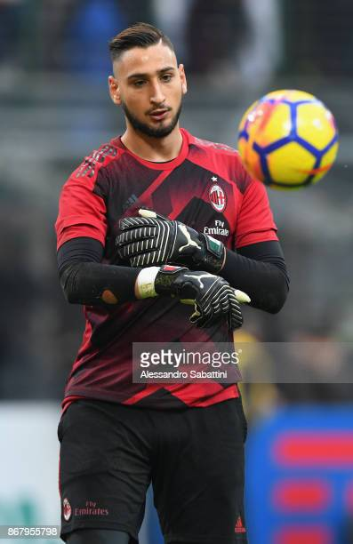 Gianluigi Donnarumma of AC Milan warms up before the Serie A match between AC Milan and Juventus at Stadio Giuseppe Meazza on October 28 2017 in...