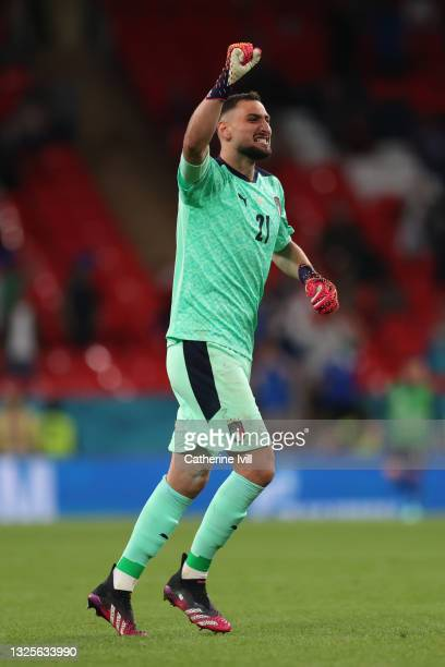 Gianluigi Donnarumma of Italy celebrates their side's first goal scored by team mate Federico Chiesa during the UEFA Euro 2020 Championship Round of...