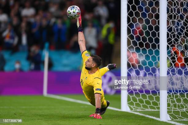 Gianluigi Donnarumma of Italy fails to save a penalty from Gerard Moreno of Spain during the penalty shoot out during the UEFA Euro 2020 Championship...