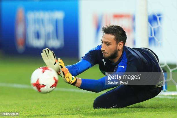 Gianluigi Donnarumma of Italy makes a save as he warms up prior to the 2017 UEFA European Under21 Championship Group C match between Italy and...