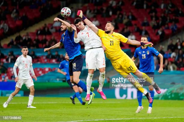 Gianluigi Donnarumma of Italy makes a save whilst under pressure from Alvaro Morata of Spain during the UEFA Euro 2020 Championship Semi-final match...