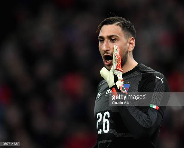 Gianluigi Donnarumma of Italy reatcs during the International Friendly match between England and Italy at Wembley Stadium on March 27, 2018 in...