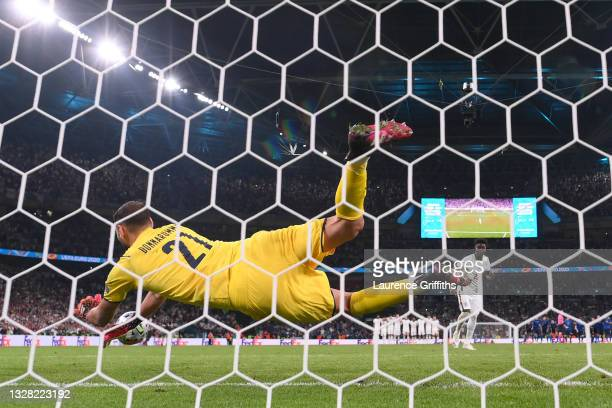 Gianluigi Donnarumma of Italy saves England's fifth, and the decisive penalty in a penalty shoot out from Bukayo Saka of England, meaning Italy win...