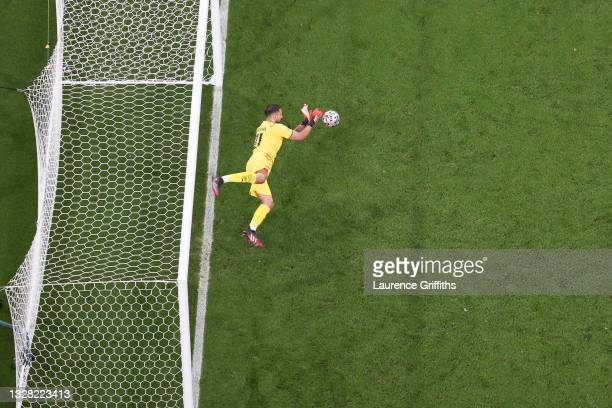 Gianluigi Donnarumma of Italy saves England's fifth, and the decisive penalty in a penalty shoot out from Bukayo Saka of England meaning Italy win...