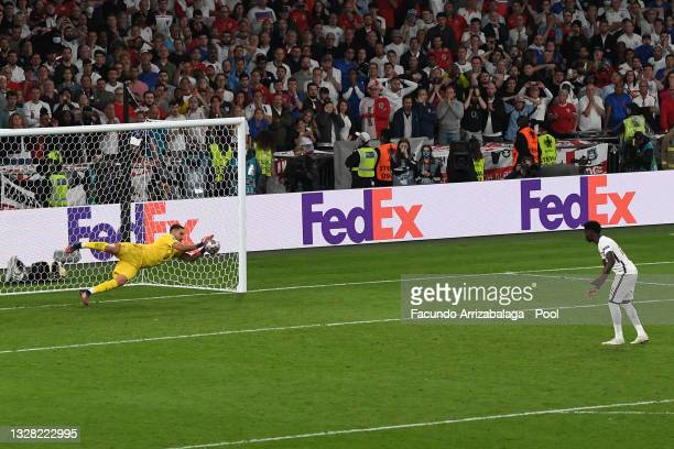 Gianluigi Donnarumma of Italy saves the England fifth penalty taken by Bukayo Saka of England leading to his team's victory during the UEFA Euro 2020...