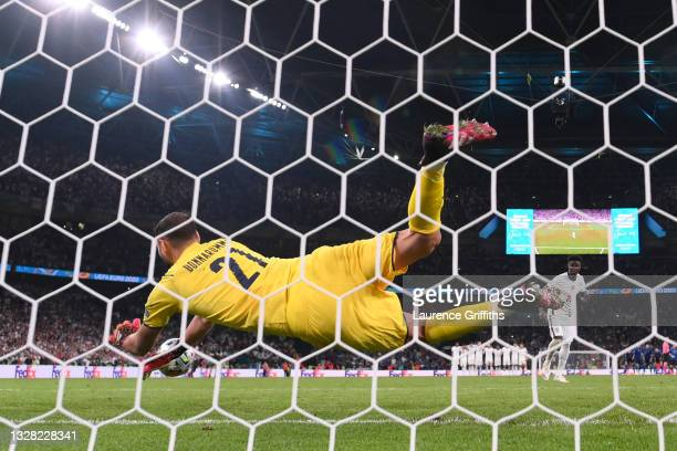Gianluigi Donnarumma of Italy saves the England fifth penalty taken by Bukayo Saka leading to their side's victory in the UEFA Euro 2020 Championship...