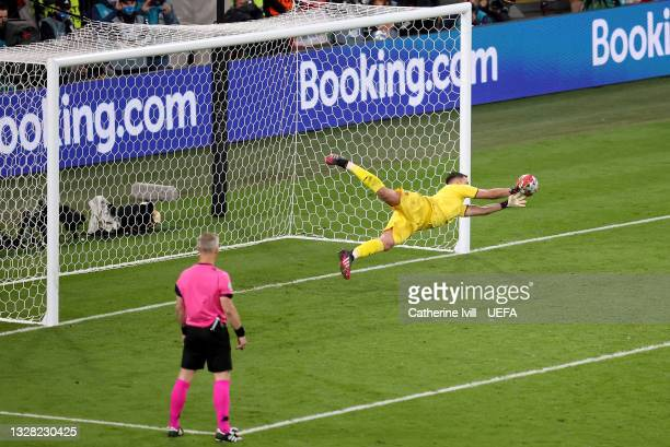 Gianluigi Donnarumma of Italy saves the fifth penalty in the penalty shoot out took by Bukayo Saka of England during the UEFA Euro 2020 Championship...