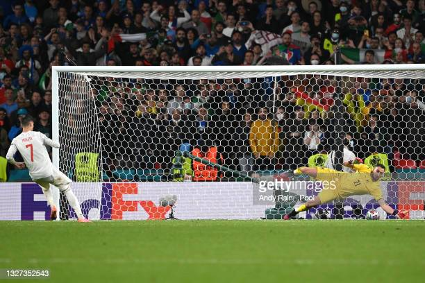 Gianluigi Donnarumma of Italy saves the fourth penalty from Alvaro Morata of Spain in the penalty shoot out during the UEFA Euro 2020 Championship...