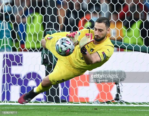 Gianluigi Donnarumma of Italy saves the game winning penalty of Bukayo Saka of England during the UEFA Euro 2020 Championship Final between Italy and...