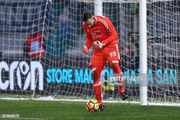 Gianluigi Donnarumma of Milan celebrates saving on Sergej MilinkovicSavic of Lazio penalty kick during the Italian Cup semi final match between Lazio...