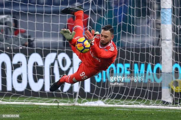 Gianluigi Donnarumma of Milan saves on Sergej MilinkovicSavic of Lazio penalty kick during the Italian Cup semi final match between Lazio and AC...