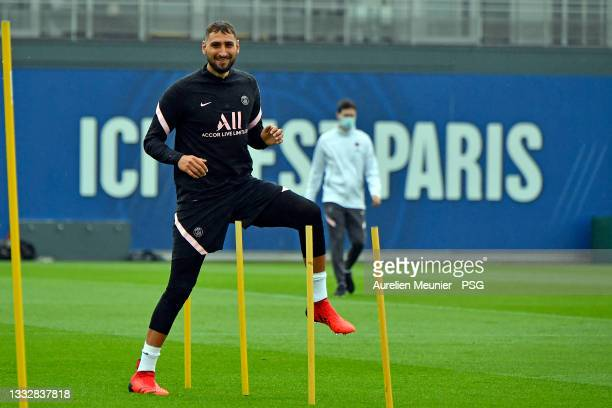 Gianluigi Donnarumma warms up during a Paris Saint-Germain training session at Ooredoo center on August 07, 2021 in Paris, France.