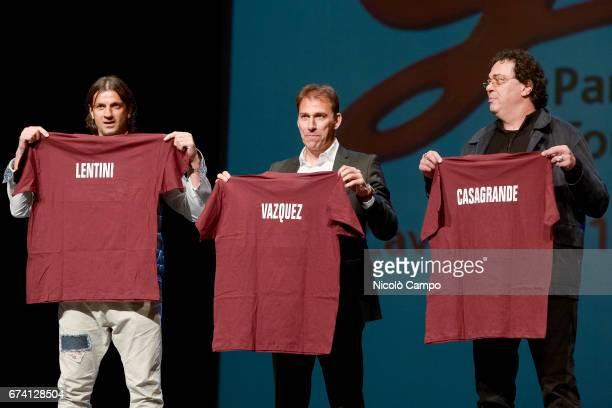 Gianluigi Lentini Rafael Martin Vazquez and Walter Casagrande show commemorative tshirts during the 'Gran Galà Granata' event to celebrate the 25th...