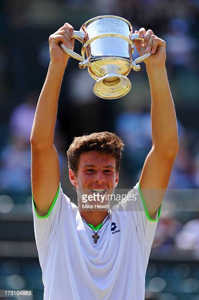 Gianluigi Quinzi of Italy poses with the trophy following his victory in the Boys' Singles Final match against Hyeon Chung of Korea on day thirteen...