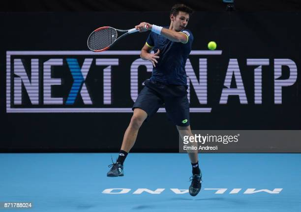 Gianluigi Quinzi of Italy returns a forehand in his match against Denis Shapovalov of Canada during Day 2 of the Next Gen ATP Finals on November 8...