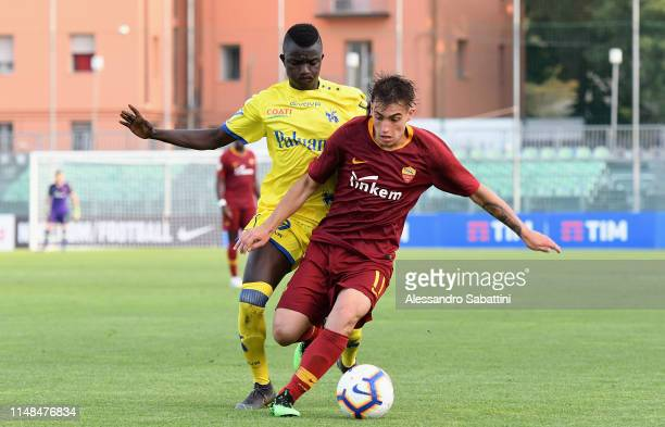 Gianmarco Cangiano of Roma competes for the ball with Musa juwara of Chievo Verona during the Serie A Primavera Playoffs AS Roma and Chievo Verona at...