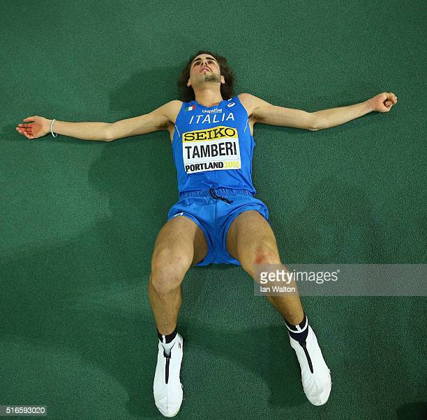 Gianmarco Tamberi of Italy lies on the track during the Men's High Jump Final during day three of the IAAF World Indoor Championships at Oregon...
