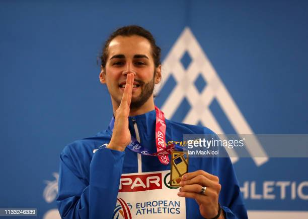 Gianmarco Tamberi of Italy poses after winning the Mens High Jump Final during the European Athletics Indoor Championships Day Two at the Emirates...