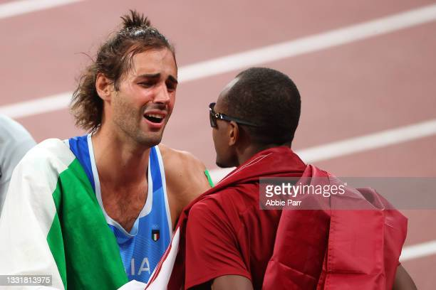 Gianmarco Tamberi of Team Italy and Mutaz Essa Barshim of Team Qatar celebrate after agreeing to share gold in the Men's High Jump Final on day nine...
