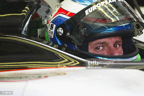 Gianmaria Bruni of Italy and Minardi keeps an eye on the timing monitors during practice for the Bahrain F1 Grand Prix at the Bahrain Racing Circuit...