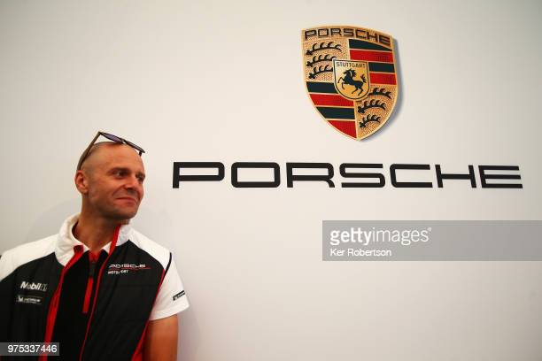 Gianmaria Bruni of Italy and the Porsche Motorsport GT Team is interviewed by the media during previews to the Le Mans 24 Hour race at the Circuit de...