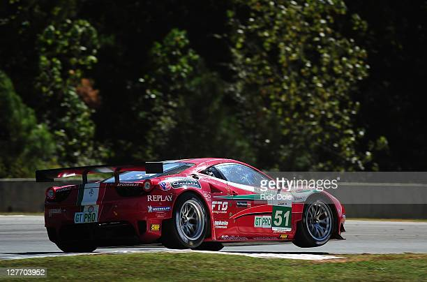 Gianmaria Bruni of Italy drives the AF Corse Ferrari 458 Italia to GT class pole position during qualifying for the American Le Mans Series Petit Le...