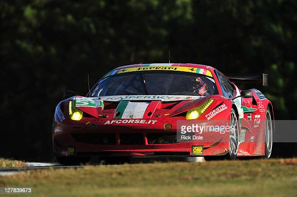 Gianmaria Bruni of Italy drives the GT class winning AF Corse Ferrari 458 iItalia during the American Le Mans Series Petit Le Mans Powered by Mazda...