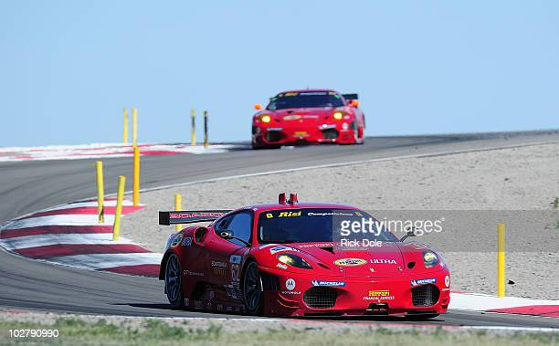Gianmaria Bruni of Italy drives the Risi Competizione Ferrari 430 GT and leads Giancarlo Fisichella of Italy driving the Risi Competizione Ferrari...