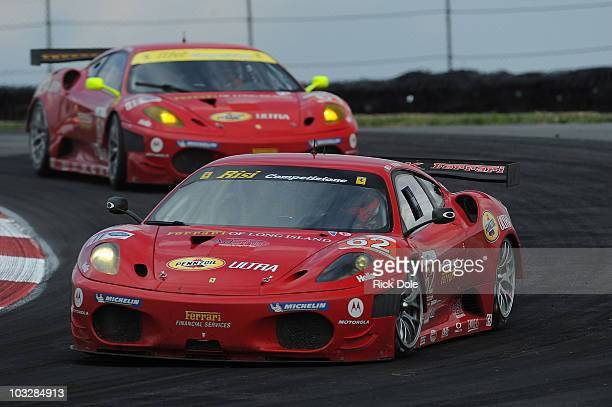 Gianmaria Bruni of Italy drives the Risi Competizione Ferrari 430 GT ahead of sister car driven by Toni Vilander of Finland during the American Le...