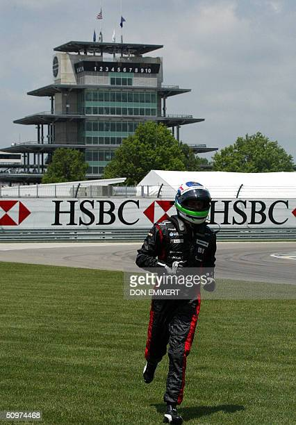 Gianmaria Bruni of Italy runs off the track after stalling out his car during practice 18 June 2004 at the US Grand Prix at the Indianapolis Motor...