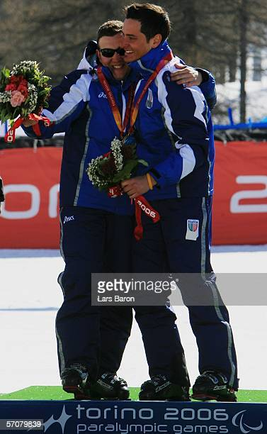 Gianmaria Dal Maistro of Italy and his guide Tommaso Balasso celebrate winning the Gold Medal in the Men's Super G Visually Impaired during Day Four...